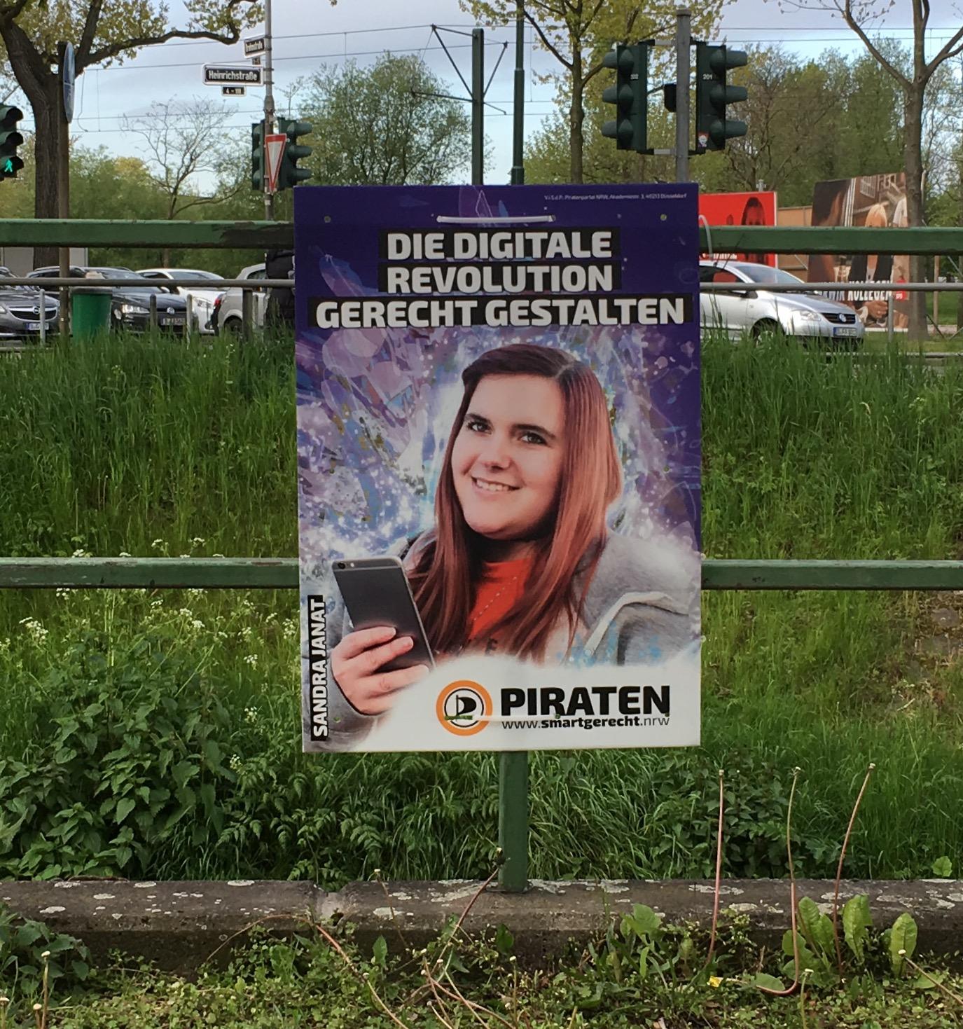 Dieses Plakat bewirbt Politik (Düsseldorf-Zoo, NRW)